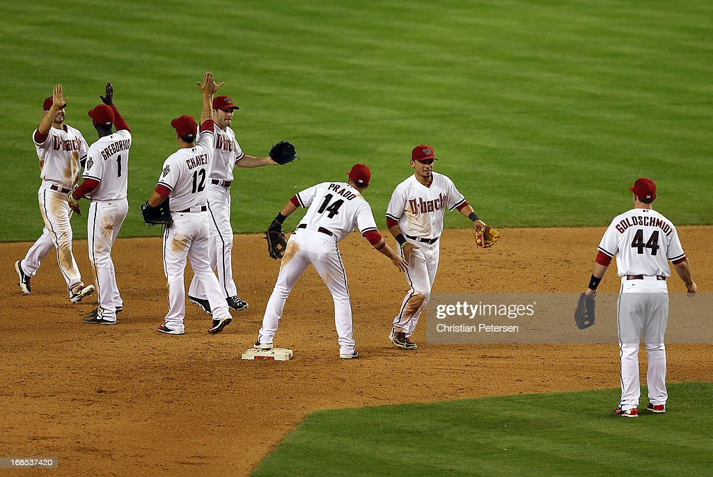 Outfielder <a gi-track='captionPersonalityLinkClicked' href=/galleries/search?phrase=Gerardo+Parra&family=editorial&specificpeople=4959447 ng-click='$event.stopPropagation()'>Gerardo Parra</a> #8 (second from right) (C) of the Arizona Diamondbacks celebrates with Martin Prado #14 after defeating the Philadelphia Phillies in the MLB game at Chase Field on May 10, 2013 in Phoenix, Arizona. The Diamondbacks defeated the Phillies 3-2.