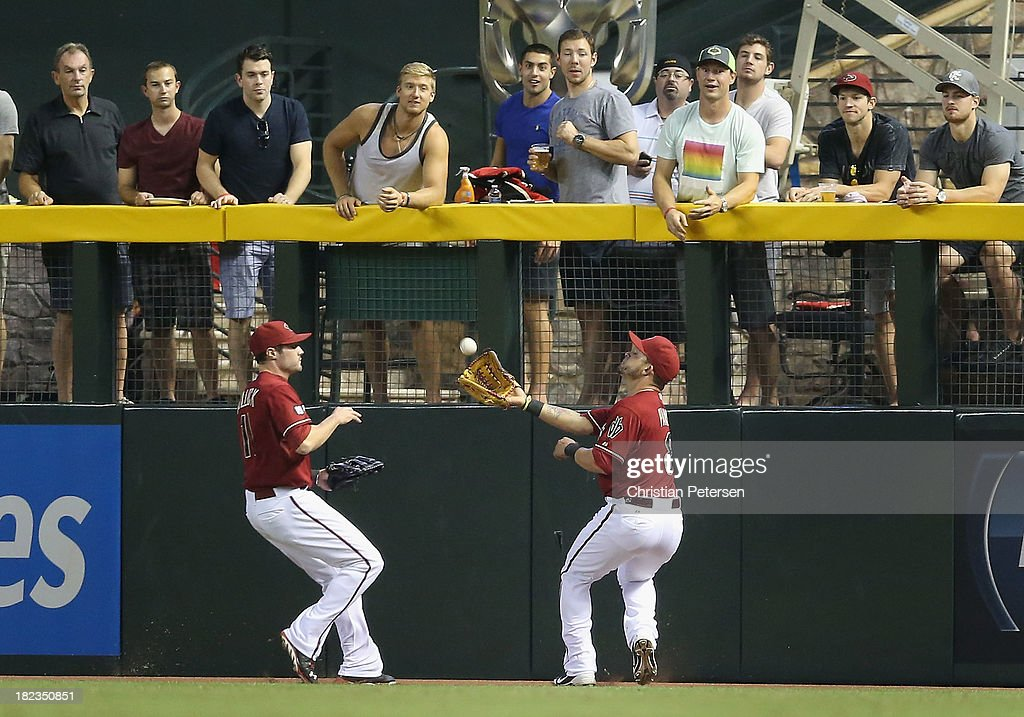 Outfielder Gerardo Parra #8 of the Arizona Diamondbacks makes a catch as members of the Phoenix Coyotes (top); including Keith Yandle, Lauri Korpikoski, David Moss, Shane Doan, Mike Smith and Mikkel Boedker, look on during the MLB game against the Washington Nationals at Chase Field on September 29, 2013 in Phoenix, Arizona.