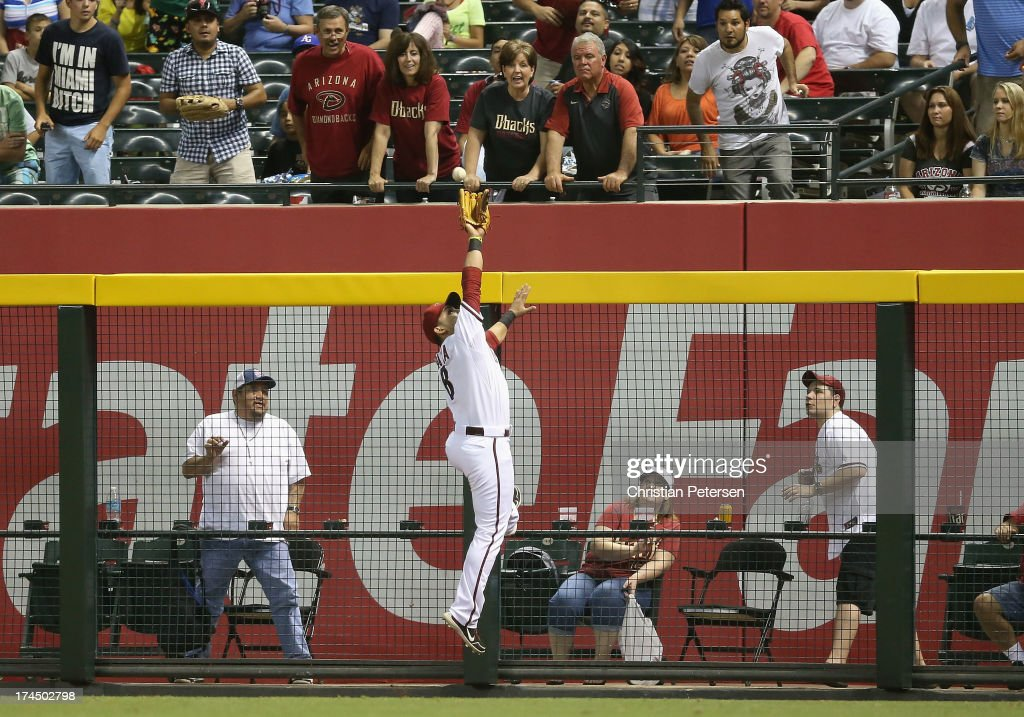 Outfielder Gerardo Parra of the Arizona Diamondbacks makes a leaping catch against the wall on a ball hit by Will Venable of the San Diego Padres...
