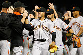 Outfielder Gregor Blanco of the San Francisco Giants highfives teammates after defeating the Arizona Diamondbacks in the MLB game at Chase Field on...