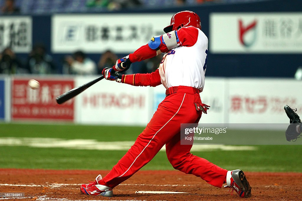 Outfielder Guillermo Heredia #17 of Cuba hits a double in the top half of the fifth inning during the friendly game between Hanshin Tigers and Cuba at Kyocera Dome Osaka on February 27, 2013 in Osaka, Japan.