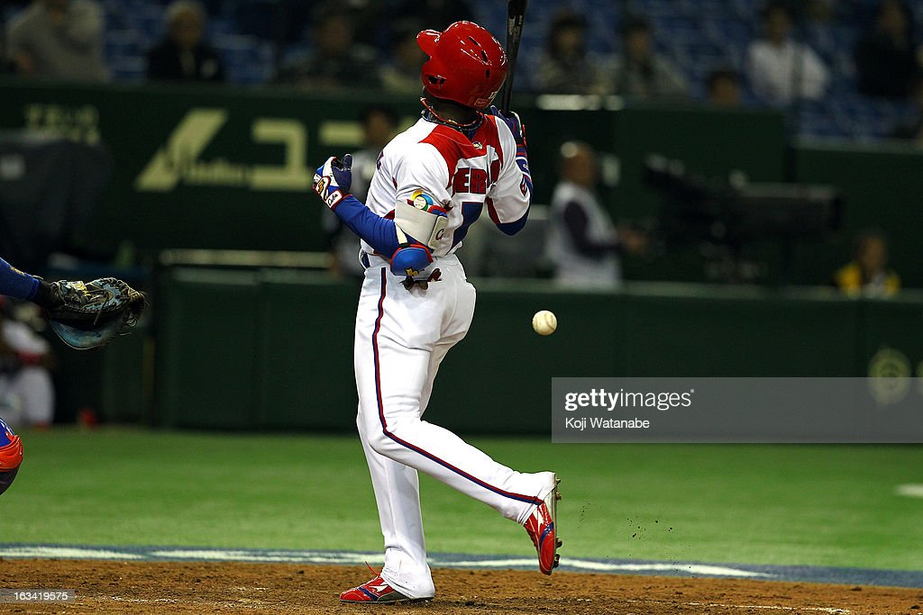 Outfielder Guillermo Heredia #17 of Cuba is hit with a pitch during the World Baseball Classic Second Round Pool 1 game between Chinese Taipei and Cuba at Tokyo Dome on March 9, 2013 in Tokyo, Japan.