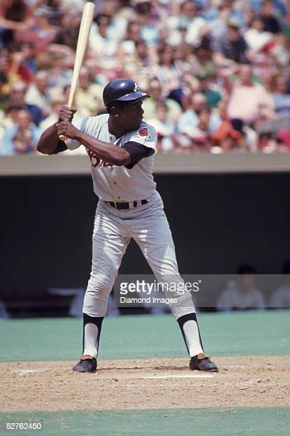 Outfielder Hank Aaron of the Atlanta Braves awaits the next pitch during a game in May 1971 against the St Louis Cardinals at Busch Stadium in St...