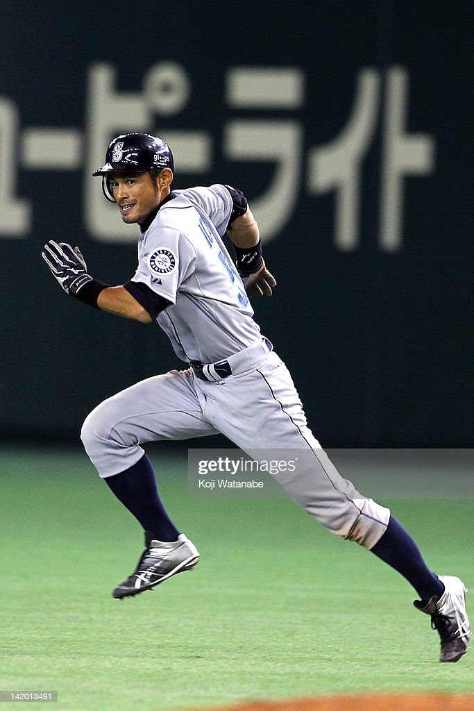 Outfielder <a gi-track='captionPersonalityLinkClicked' href=/galleries/search?phrase=Ichiro+Suzuki&family=editorial&specificpeople=201556 ng-click='$event.stopPropagation()'>Ichiro Suzuki</a> #51 of Seattle Mariners hits a single against the Oakland Athletics at Tokyo Dome on March 28, 2012 in Tokyo, Japan.