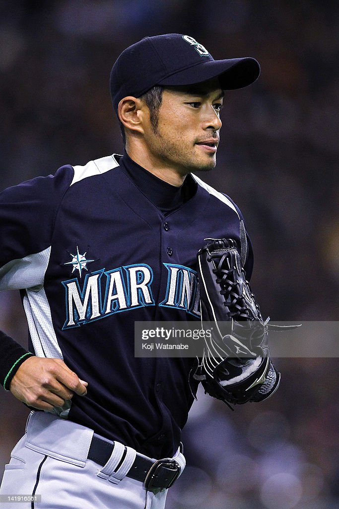 Outfielder <a gi-track='captionPersonalityLinkClicked' href=/galleries/search?phrase=Ichiro+Suzuki&family=editorial&specificpeople=201556 ng-click='$event.stopPropagation()'>Ichiro Suzuki</a> #51 of Seattle Mariners in action during in the bottom half of the third inning the pre season game between Yomiuri Giants and Seattle Mariners at Tokyo Dome on March 26, 2012 in Tokyo, Japan.
