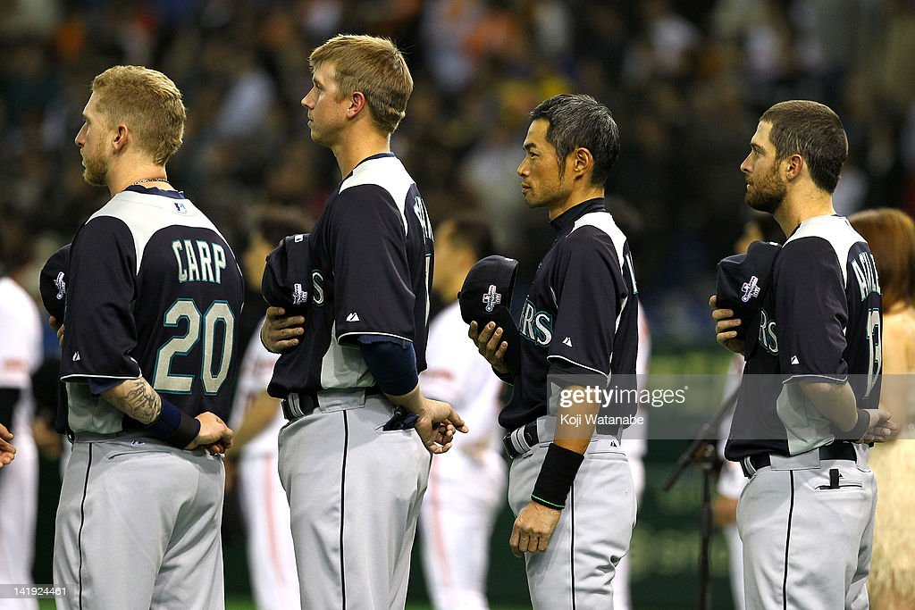 Outfielder Ichiro Suzuki #51 of Seattle Mariners line up for national anthem during the pre season game between Yomiuri Giants and Seattle Mariners at Tokyo Dome on March 26, 2012 in Tokyo, Japan.