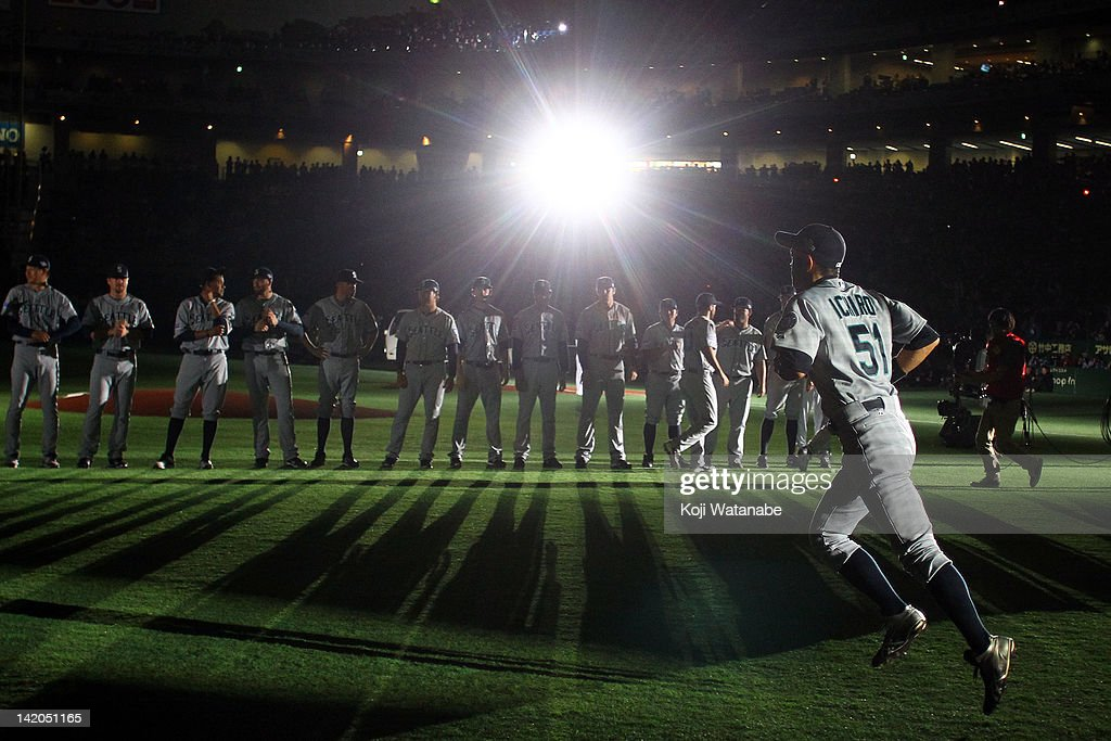 Outfielder <a gi-track='captionPersonalityLinkClicked' href=/galleries/search?phrase=Ichiro+Suzuki&family=editorial&specificpeople=201556 ng-click='$event.stopPropagation()'>Ichiro Suzuki</a> (R) of Seattle Mariners runs to line up for national anthem during MLB match between Seattle Mariners and Oakland Athletics at Tokyo Dome on March 29, 2012 in Tokyo, Japan.