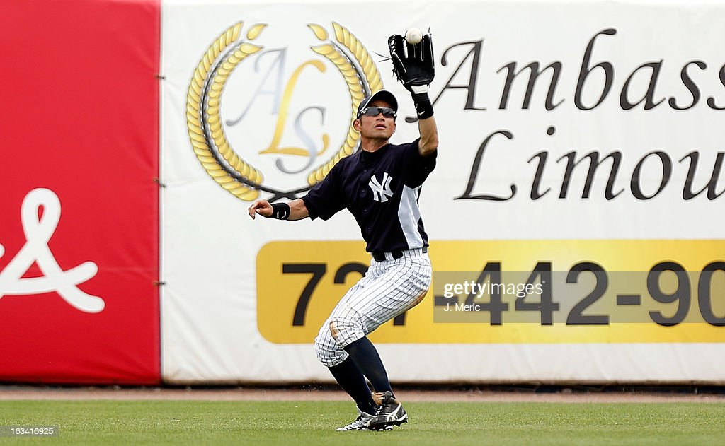 Outfielder <a gi-track='captionPersonalityLinkClicked' href=/galleries/search?phrase=Ichiro+Suzuki&family=editorial&specificpeople=201556 ng-click='$event.stopPropagation()'>Ichiro Suzuki</a> #31 of the New York Yankees catches a fly ball against the Atlanta Braves during a Grapefruit League Spring Training Game at George M. Steinbrenner Field on March 9, 2013 in Tampa, Florida.