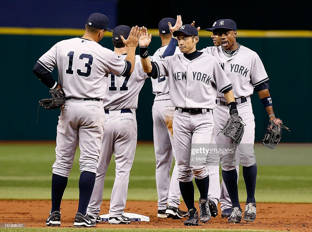Outfielder <a gi-track='captionPersonalityLinkClicked' href=/galleries/search?phrase=Ichiro+Suzuki&family=editorial&specificpeople=201556 ng-click='$event.stopPropagation()'>Ichiro Suzuki</a> #31 of the New York Yankees celebrates his team's victory over the Tampa Bay Rays at Tropicana Field on September 5, 2012 in St. Petersburg, Florida.