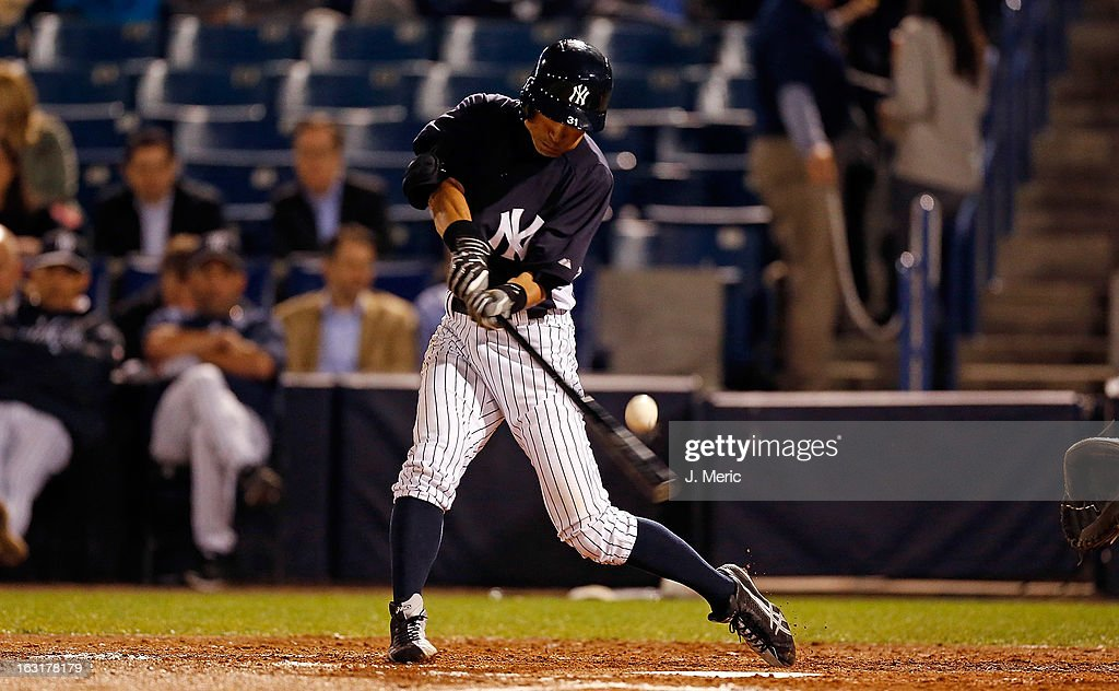 Outfielder <a gi-track='captionPersonalityLinkClicked' href=/galleries/search?phrase=Ichiro+Suzuki&family=editorial&specificpeople=201556 ng-click='$event.stopPropagation()'>Ichiro Suzuki</a> #31 of the New York Yankees fouls off a pitch against the Atlanta Braves during a Grapefruit League Spring Training Game at George M. Steinbrenner Field on March 5, 2013 in Tampa, Florida.