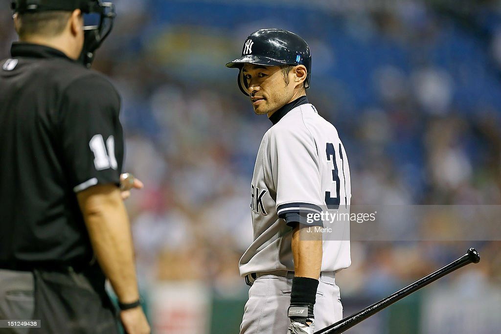 Outfielder Ichiro Suzuki #31 of the New York Yankees glares at the umpire after a called strike three against the Tampa Bay Rays during the game at Tropicana Field on September 4, 2012 in St. Petersburg, Florida.