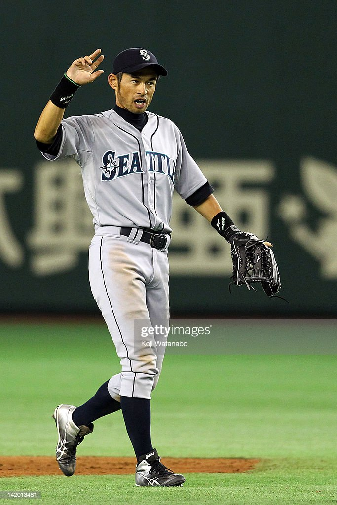Outfielder <a gi-track='captionPersonalityLinkClicked' href=/galleries/search?phrase=Ichiro+Suzuki&family=editorial&specificpeople=201556 ng-click='$event.stopPropagation()'>Ichiro Suzuki</a> #51 of the Seattle Mariners celebrates after defeating the Oakland Athletics at Tokyo Dome on March 28, 2012 in Tokyo, Japan.