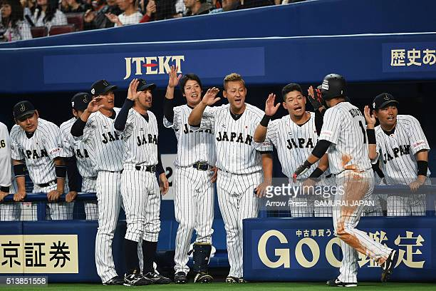 Outfielder Ikuhiro Kiyota of Japan celebrates scoring by two run double by Catcher Yuhei Nakamura with his team mates in the bottom of second inning...