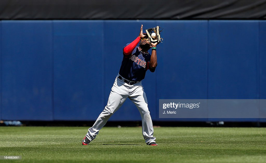 Outfielder Jackie Bradley Jr. #74 of the Boston Red Sox catches a fly ball against the Tampa Bay Rays during a Grapefruit League Spring Training Game at the Charlotte Sports Complex on March 16, 2013 in Port Charlotte, Florida.