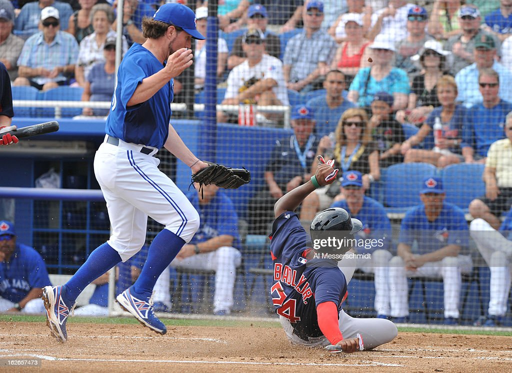 Outfielder Jackie Bradley Jr. #74 of the Boston Red Sox slides into home plate after a wild pitch against the Toronto Blue Jays during a preason game February 25, 2013 at the Florida Auto Exchange Stadium in Dunedin, Florida.