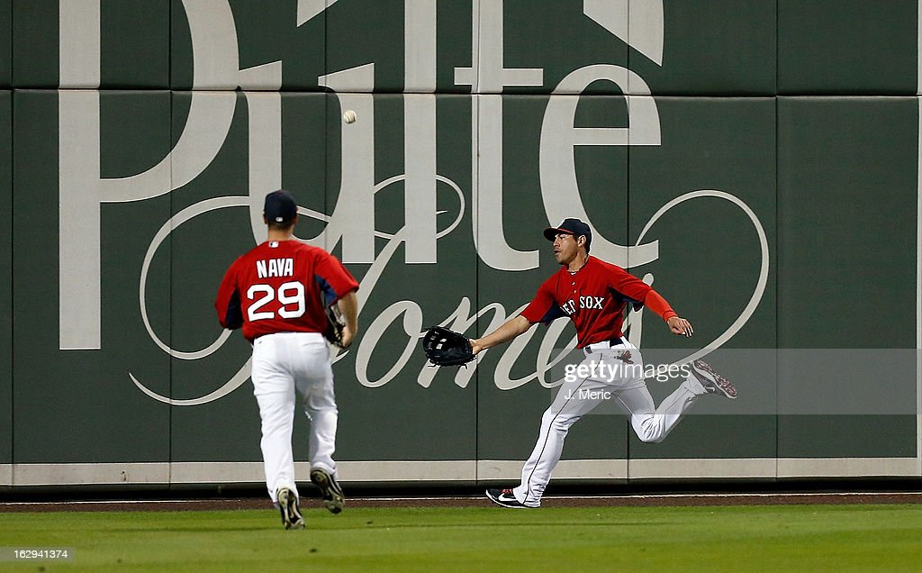 Outfielder <a gi-track='captionPersonalityLinkClicked' href=/galleries/search?phrase=Jacoby+Ellsbury&family=editorial&specificpeople=4172583 ng-click='$event.stopPropagation()'>Jacoby Ellsbury</a> #2 of the Boston Red Sox cannot get to this fly ball as <a gi-track='captionPersonalityLinkClicked' href=/galleries/search?phrase=Daniel+Nava&family=editorial&specificpeople=670454 ng-click='$event.stopPropagation()'>Daniel Nava</a> #29 looks on against the Pittsburgh Pirates during a Grapefruit League Spring Training Game at JetBlue Park on March 1, 2013 in Fort Myers, Florida.