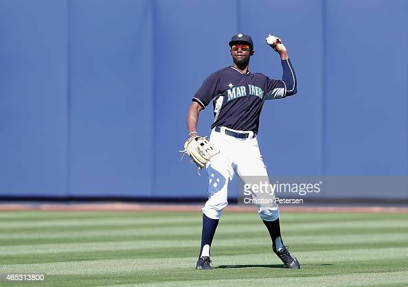 Outfielder James Jones of the Seattle Mariners fields an out during the spring training game against the San Diego Padres at Peoria Stadium on March...
