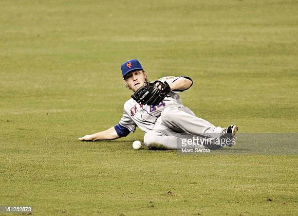 Outfielder Jason Bay of the New York Mets cannot make a catch against the Miami Marlins at Marlins Park on September 2 2012 in Miami Florida