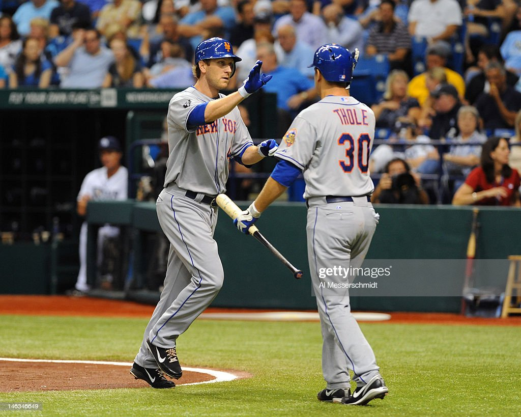 Outfielder <a gi-track='captionPersonalityLinkClicked' href=/galleries/search?phrase=Jason+Bay&family=editorial&specificpeople=214251 ng-click='$event.stopPropagation()'>Jason Bay</a> #44 of the New York Mets celebrates a home run with <a gi-track='captionPersonalityLinkClicked' href=/galleries/search?phrase=Josh+Thole&family=editorial&specificpeople=5741573 ng-click='$event.stopPropagation()'>Josh Thole</a> #30 against the Tampa Bay Rays June 14, 2012 at Tropicana Field in St. Petersburg, Florida.