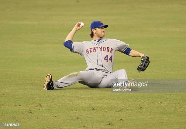 Outfielder Jason Bay of the New York Mets throws the ball after missing a catch against the Miami Marlins at Marlins Park on September 2 2012 in...