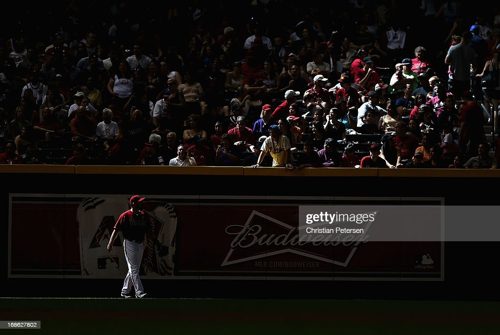 Outfielder <a gi-track='captionPersonalityLinkClicked' href=/galleries/search?phrase=Jason+Kubel&family=editorial&specificpeople=575883 ng-click='$event.stopPropagation()'>Jason Kubel</a> #13 of the Arizona Diamondbacks stands in left field during the MLB game against the Philadelphia Phillies at Chase Field on May 12, 2013 in Phoenix, Arizona.