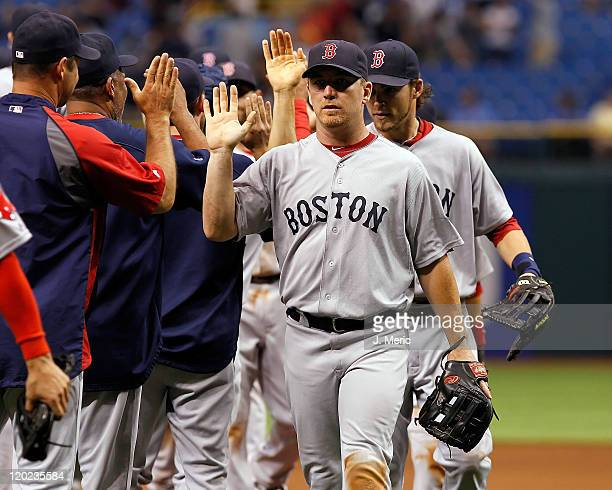 Outfielder JD Drew of the Boston Red Sox is congratulated after a win against the Tampa Bay Rays at Tropicana Field on July 16 2011 in St Petersburg...