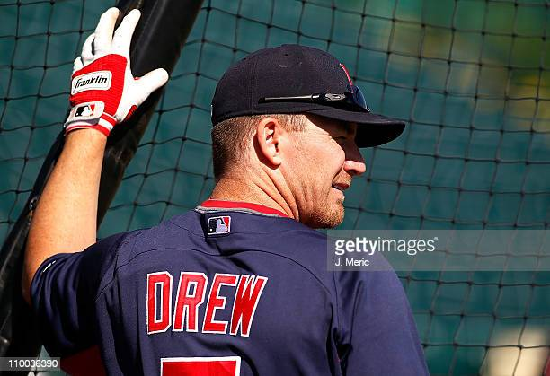 Outfielder JD Drew of the Boston Red Sox takes batting practice just prior to the start of the Grapefruit League Spring Training Game against the...