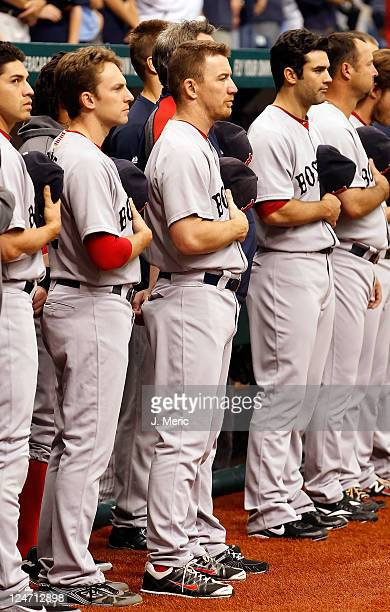 Outfielder JD Drew of the Boston Red Sox watches the pregame ceremonies just before the start of the game against the Tampa Bay Rays at Tropicana...