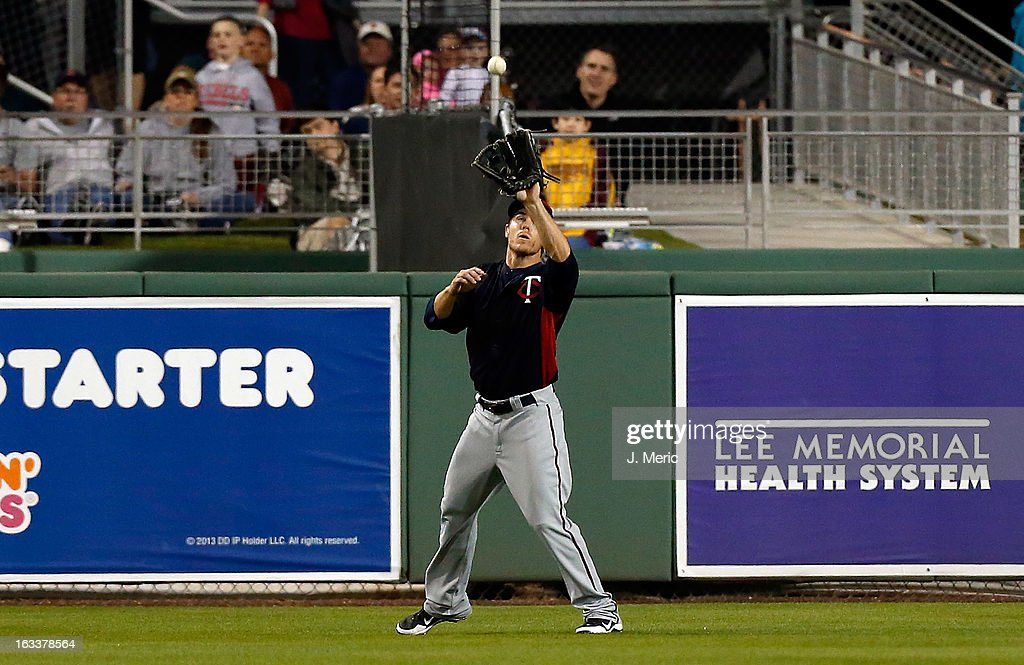 Outfielder Joe Benson #12 of the Minnesota Twins catches a fly ball against the Boston Red Sox during a Grapefruit League Spring Training Game at JetBlue Park on March 8, 2013 in Fort Myers, Florida.