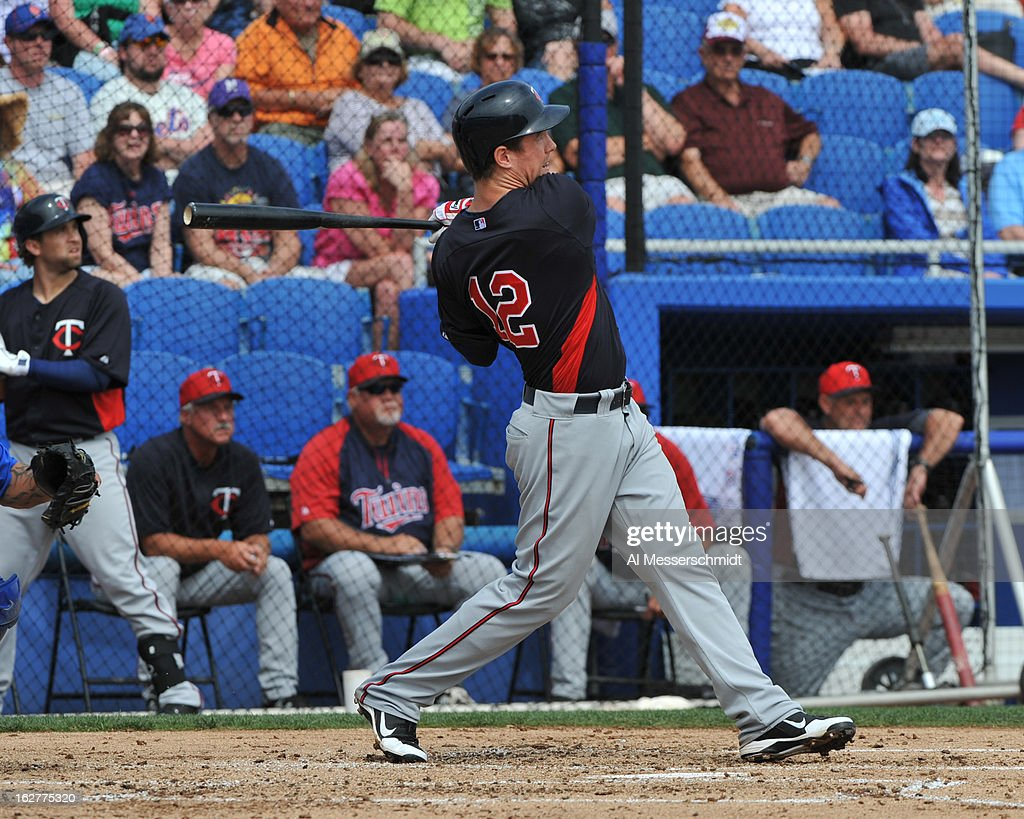 Outfielder Joe Benson of the Minnesota Twins hits a home run against the Toronto Blue Jays February 26, 2013 at the Florida Auto Exchange Stadium in Dunedin, Florida.