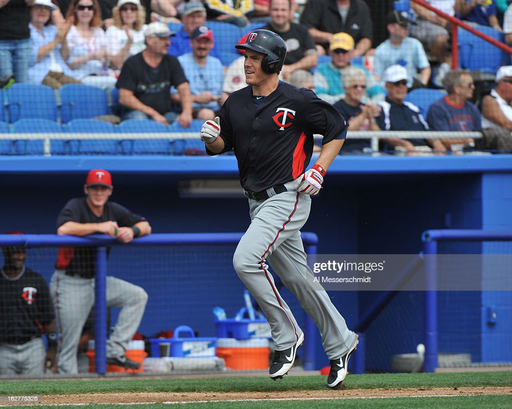 Outfielder Joe Benson of the Minnesota Twins runs the bases after hitting a homer run against the Toronto Blue Jays February 26, 2013 at the Florida Auto Exchange Stadium in Dunedin, Florida.