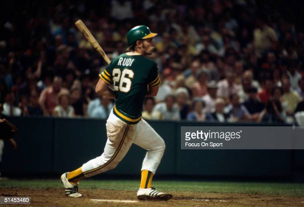 Outfielder Joe Rudi of the Oakland Athletics follows through his swing at the OaklandAlameda County Coliseum during the World Series against the New...