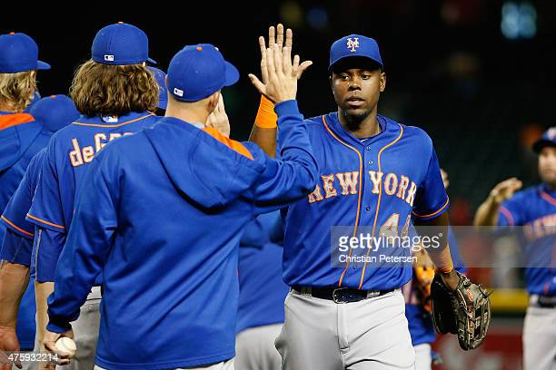 Outfielder John Mayberry Jr #44 of the New York Mets celebrates with teammates after defeating the Arizona Diamondbacks 62 in the MLB game at Chase...