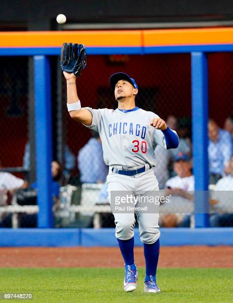 Outfielder Jon Jay of the Chicago Cubs catches a fly ball in an MLB baseball game against the New York Mets on June 14 2017 at CitiField in the...