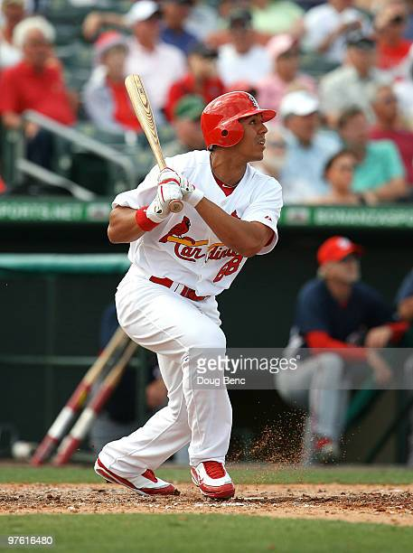 Outfielder Jon Jay of the St Louis Cardinals hits a triple against the Washington Nationals at Roger Dean Stadium on March 10 2010 in Jupiter Florida