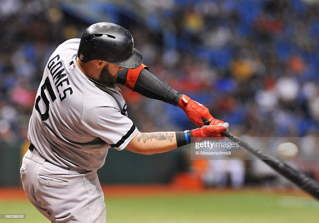 Outfielder <a gi-track='captionPersonalityLinkClicked' href=/galleries/search?phrase=Jonny+Gomes&family=editorial&specificpeople=568435 ng-click='$event.stopPropagation()'>Jonny Gomes</a> #5 of the Boston Red Sox bats against the Tampa Bay Rays September 10, 2013 at Tropicana Field in St. Petersburg, Florida.