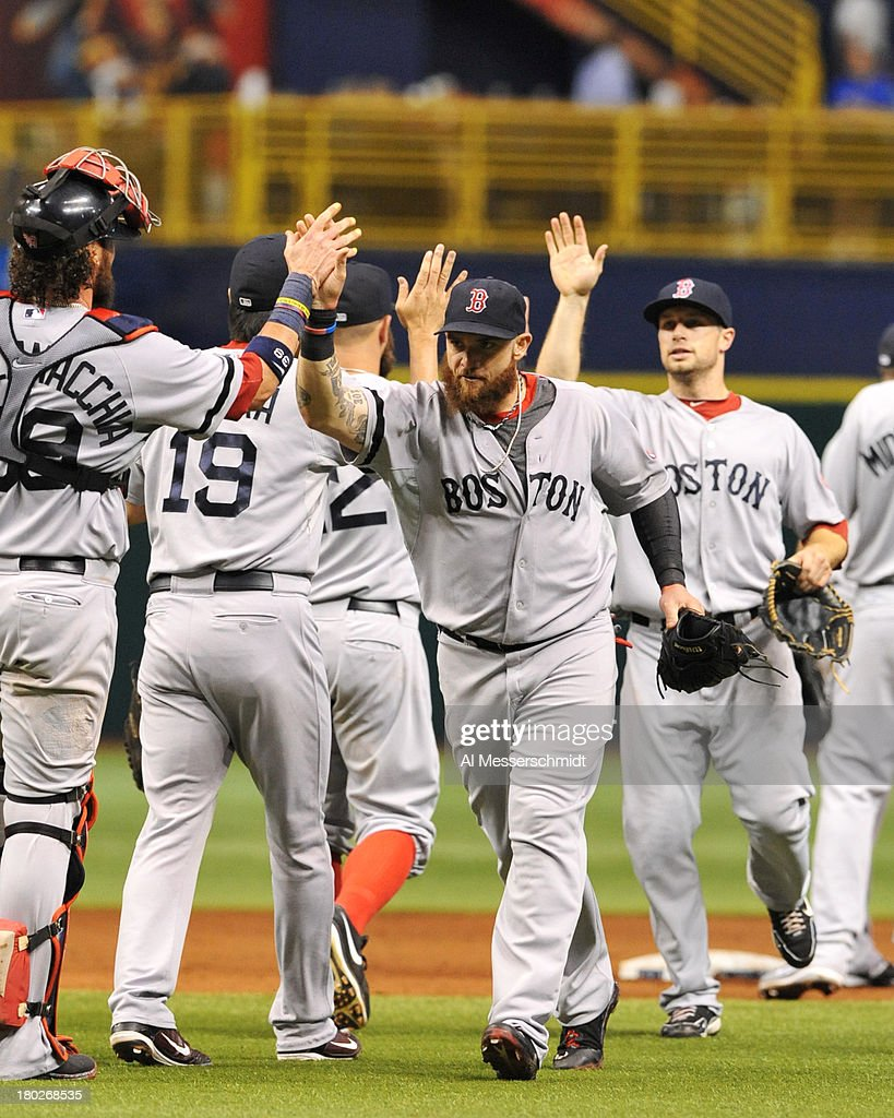 Outfielder <a gi-track='captionPersonalityLinkClicked' href=/galleries/search?phrase=Jonny+Gomes&family=editorial&specificpeople=568435 ng-click='$event.stopPropagation()'>Jonny Gomes</a> #5 of the Boston Red Sox celebrates after a 2 - 0 win against the Tampa Bay Rays September 10, 2013 at Tropicana Field in St. Petersburg, Florida.