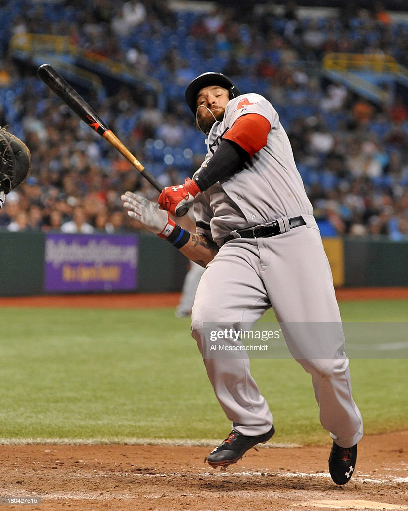 Outfielder Jonny Gomes #5 of the Boston Red Sox jumps away from an inside pitch to lead off the 9th inning against the Tampa Bay Rays September 12, 2013 at Tropicana Field in St. Petersburg, Florida. Tampa won 4 - 3.