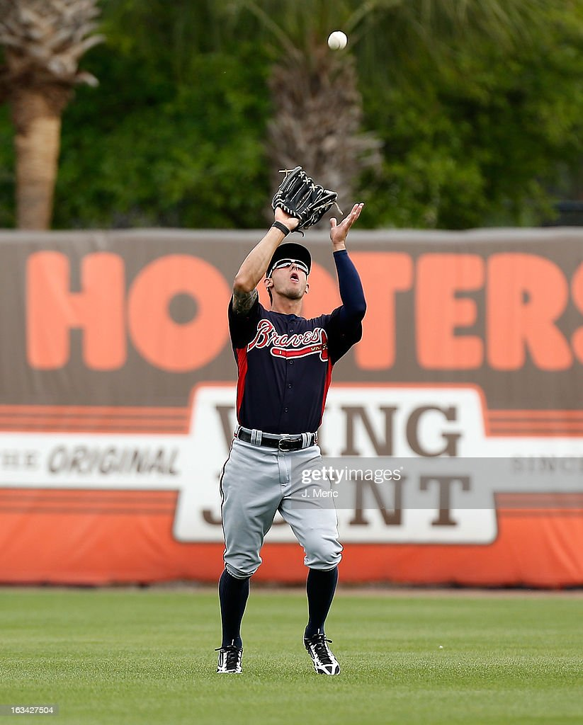 Outfielder Jordan Schafer #17 of the Atlanta Braves catches a fly ball against the New York Yankees during a Grapefruit League Spring Training Game at George M. Steinbrenner Field on March 9, 2013 in Tampa, Florida.