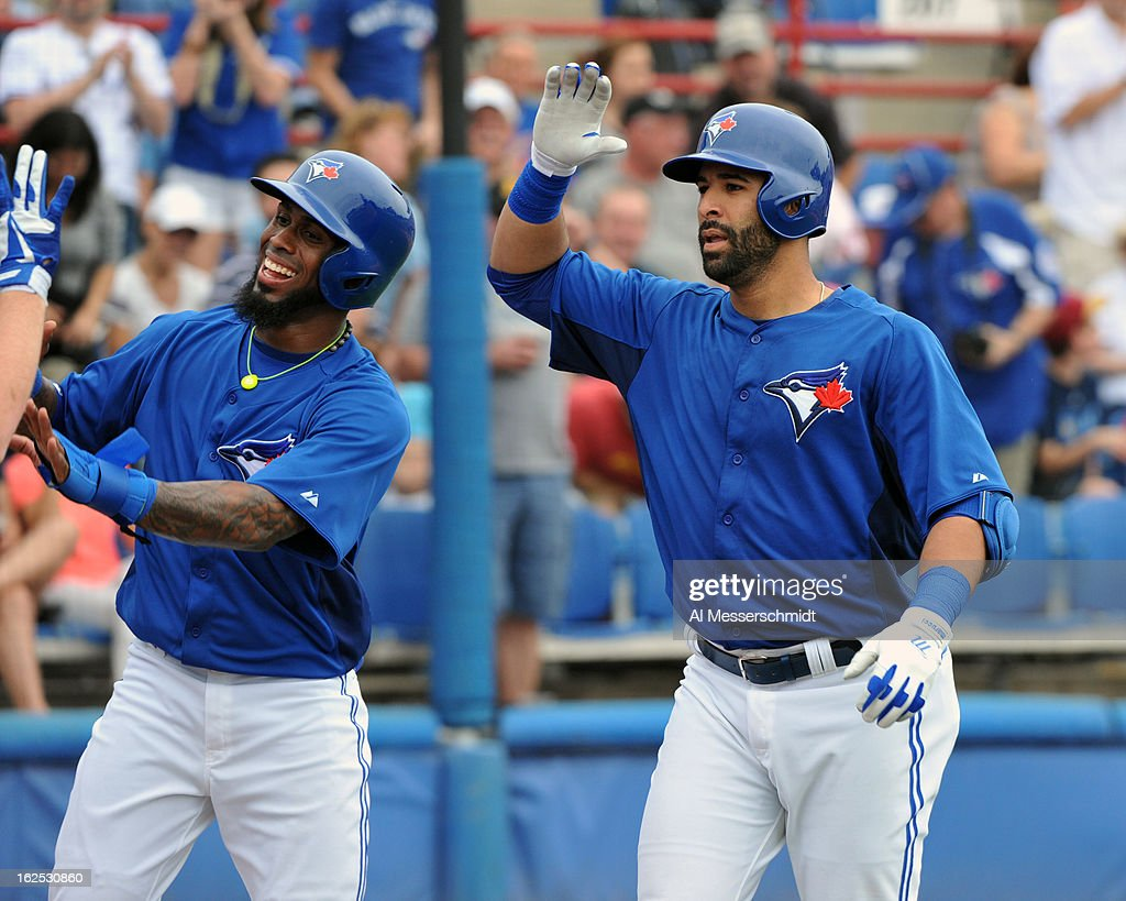 Outfielder Jose Bautista #19 of the Toronto Blue Jays celebrates with infielder Jose Reyes #7 after a home run against the Baltimore Orioles February 24, 2013 at the Florida Auto Exchange Stadium in Dunedin, Florida.