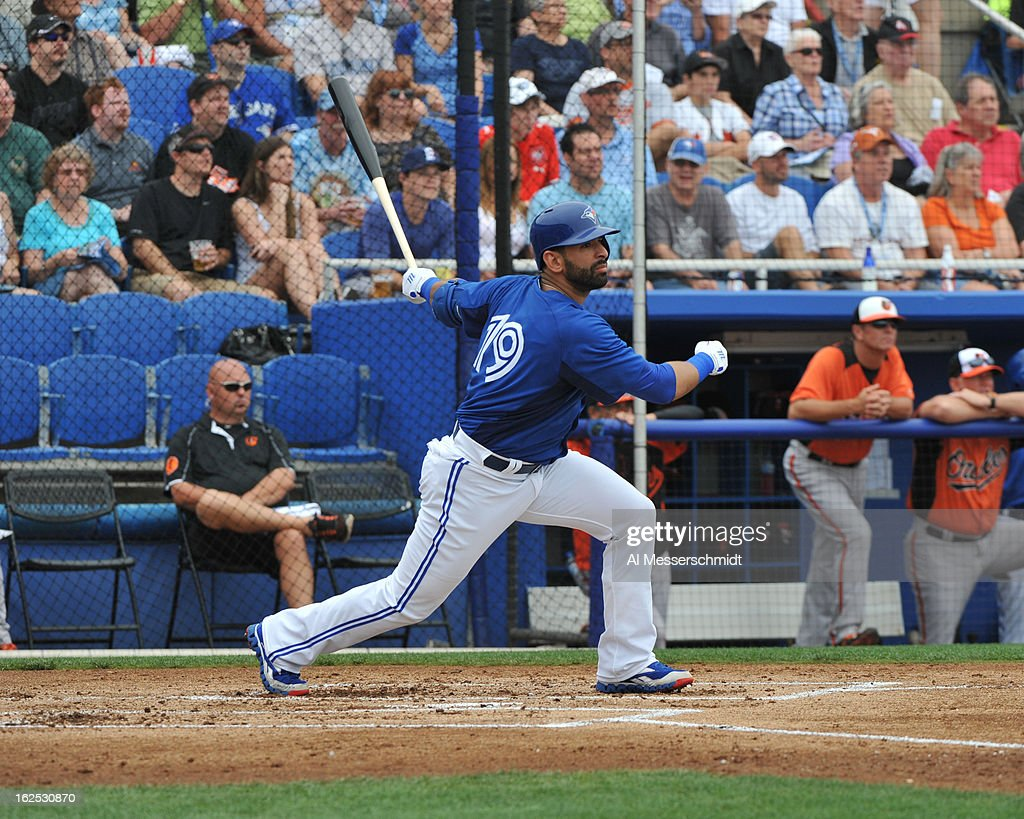 Outfielder Jose Bautista #19 of the Toronto Blue Jays homers against the Baltimore Orioles February 24, 2013 at the Florida Auto Exchange Stadium in Dunedin, Florida.