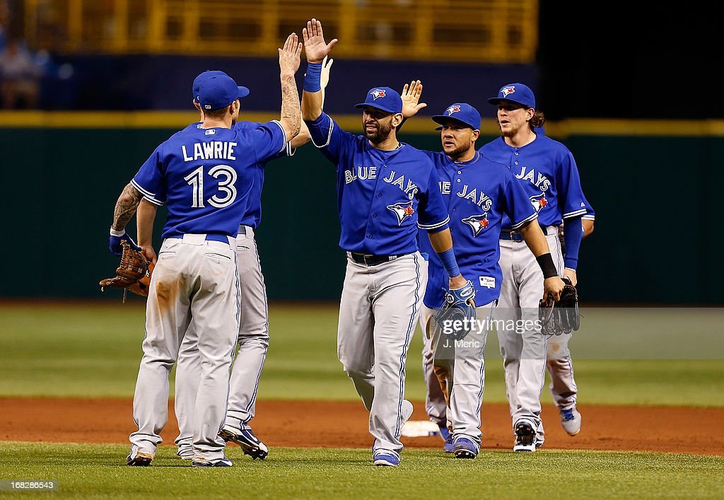 Outfielder Jose Bautista #19 of the Toronto Blue Jays is congratulated by <a gi-track='captionPersonalityLinkClicked' href=/galleries/search?phrase=Brett+Lawrie&family=editorial&specificpeople=5496694 ng-click='$event.stopPropagation()'>Brett Lawrie</a> #13 after the Blue Jays victory over the Tampa Bay Rays at Tropicana Field on May 7, 2013 in St. Petersburg, Florida.