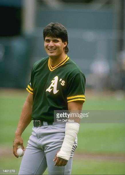 Outfielder Jose Canseco of the Oakland Athletics looks on Mandatory Credit Tim de Frisco /Allsport