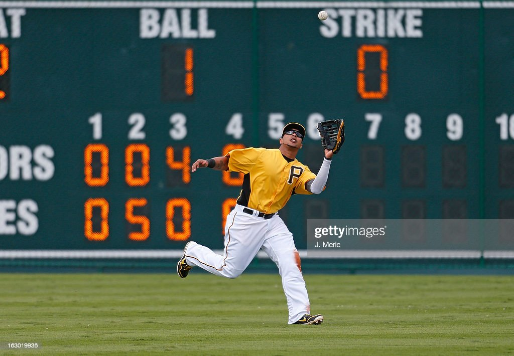 Outfielder Jose Tabata #31 of the Pittsburgh Pirates catches a fly ball against the Houston Astros during a Grapefruit League Spring Training Game at McKechnie Field on March 3, 2013 in Bradenton, Florida.