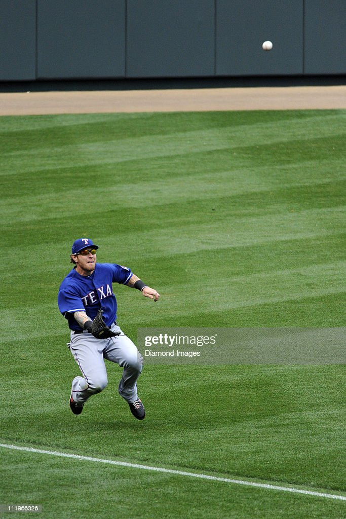 Outfielder <a gi-track='captionPersonalityLinkClicked' href=/galleries/search?phrase=Josh+Hamilton+-+Baseball+Player&family=editorial&specificpeople=234355 ng-click='$event.stopPropagation()'>Josh Hamilton</a> #32 of the Texas Rangers makes a sliding catch of the sinking line drive off the bat of catcher Matt Wieters #32 of the Baltimore Orioles during the bottom of the ninth inning of a game on April 10, 2011 at Oriole Park in Baltimore, Maryland.