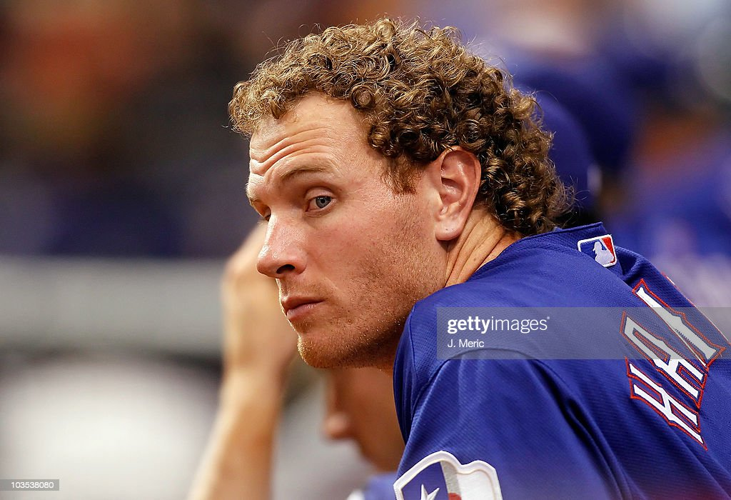 Outfielder <a gi-track='captionPersonalityLinkClicked' href=/galleries/search?phrase=Josh+Hamilton+-+Baseball+Player&family=editorial&specificpeople=234355 ng-click='$event.stopPropagation()'>Josh Hamilton</a> #32 of the Texas Rangers watches his team from the dugout during the game against the Tampa Bay Rays at Tropicana Field on August 17, 2010 in St. Petersburg, Florida.