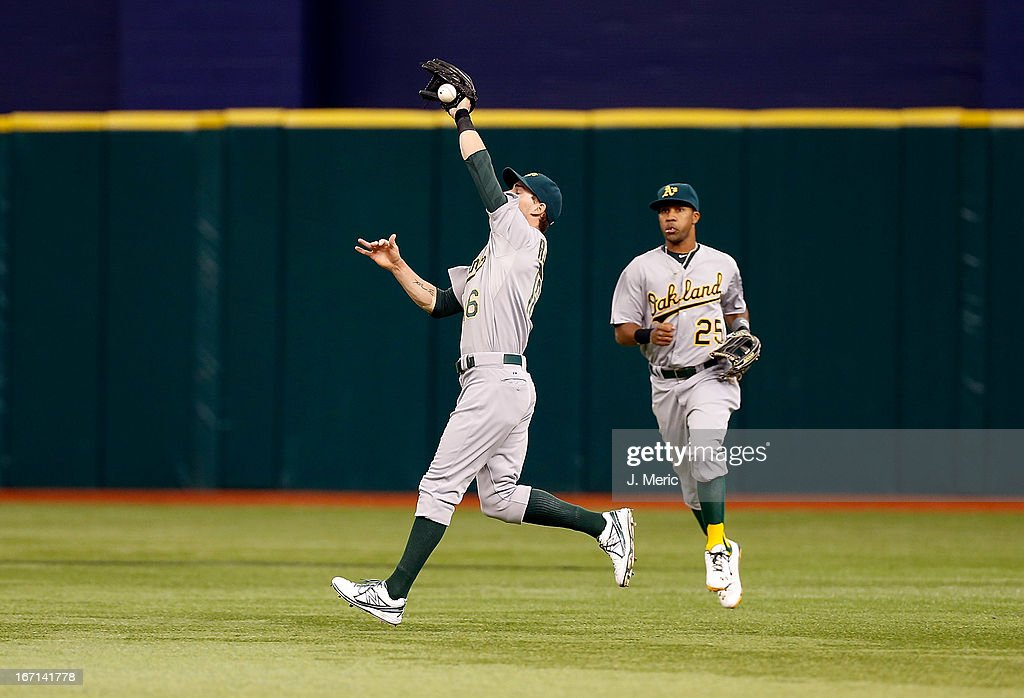 Outfielder <a gi-track='captionPersonalityLinkClicked' href=/galleries/search?phrase=Josh+Reddick&family=editorial&specificpeople=5746348 ng-click='$event.stopPropagation()'>Josh Reddick</a> #16 of the Oakland Athletics cannot come up with this fly ball against the Tampa Bay Rays during the game at Tropicana Field on April 21, 2013 in St. Petersburg, Florida.