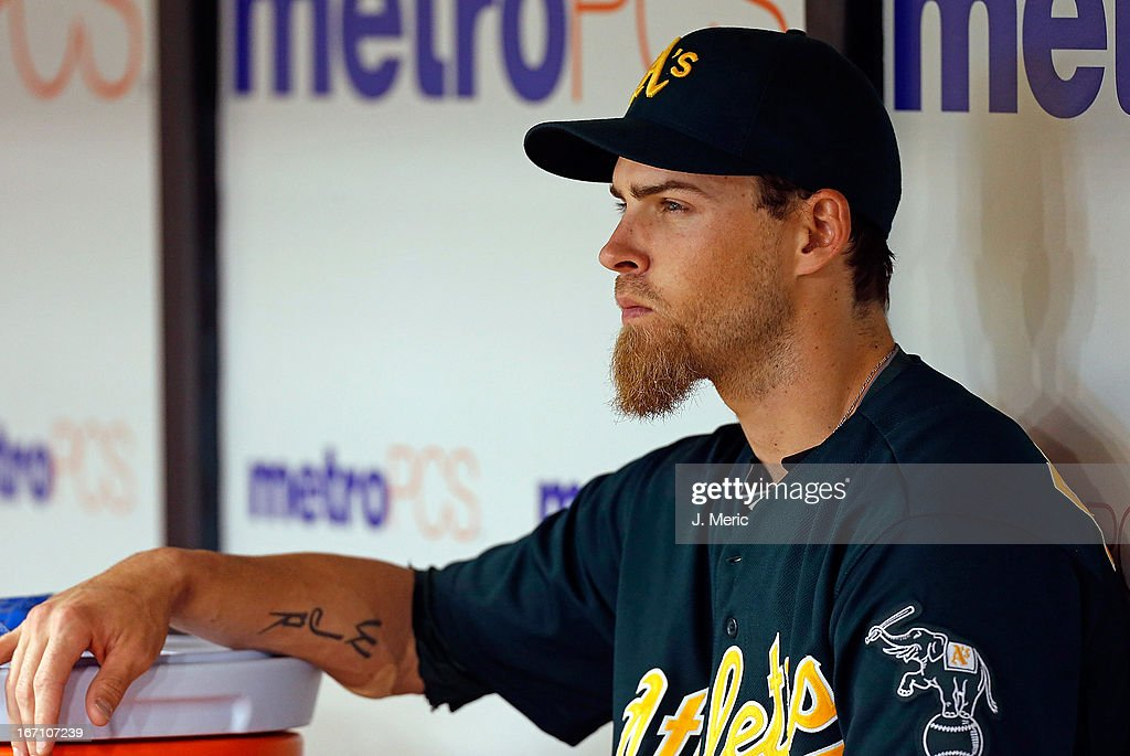 Outfielder <a gi-track='captionPersonalityLinkClicked' href=/galleries/search?phrase=Josh+Reddick&family=editorial&specificpeople=5746348 ng-click='$event.stopPropagation()'>Josh Reddick</a> #16 of the Oakland Athletics watches his team from the bench against the Tampa Bay Rays during the game at Tropicana Field on April 20, 2013 in St. Petersburg, Florida.