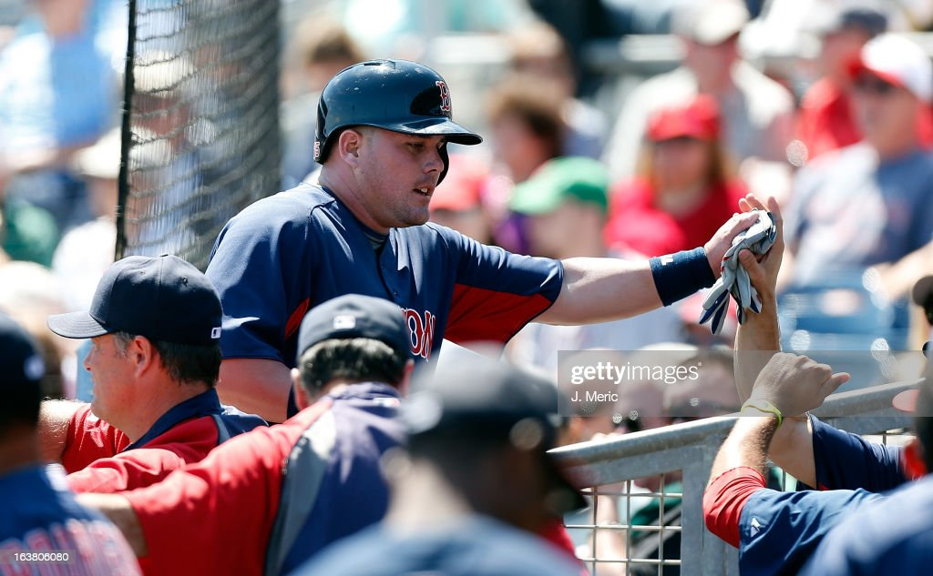 Outfielder Juan Carlos Linares #75 of the Boston Red Sox is congratulated after scoring in the first against the Tampa Bay Rays during a Grapefruit League Spring Training Game at the Charlotte Sports Complex on March 16, 2013 in Port Charlotte, Florida.