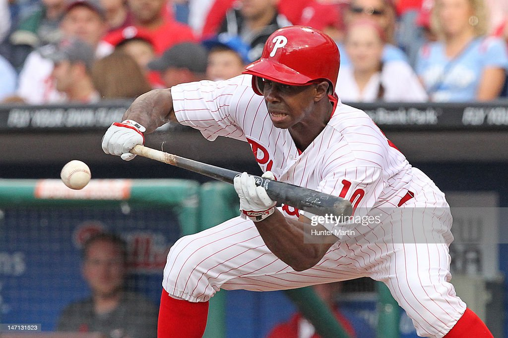 Outfielder <a gi-track='captionPersonalityLinkClicked' href=/galleries/search?phrase=Juan+Pierre&family=editorial&specificpeople=202961 ng-click='$event.stopPropagation()'>Juan Pierre</a> #10 of the Philadelphia Phillies bunts during a game against the Pittsburgh Pirates at Citizens Bank Park on June 25, 2012 in Philadelphia, Pennsylvania.